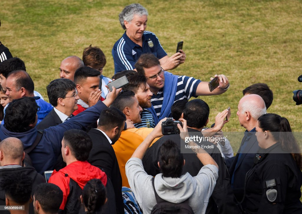 Lionel Messi poses for selfies with fans during a training session open to the public as part of the team preparation for FIFA World Cup Russia 2018 at Tomas Adolfo Duco Stadium on May 27, 2018 in Buenos Aires, Argentina.