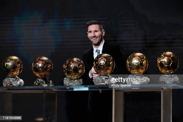 Lionel Messi poses onstage after winning his sixth Ballon D'Or award during the Ballon D'Or Ceremony at Theatre Du Chatelet on December 02 2019 in...
