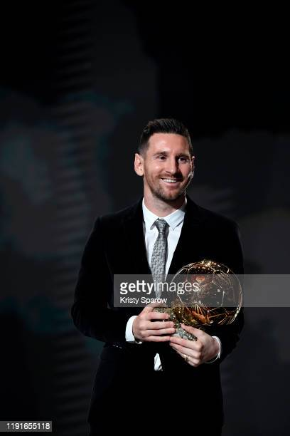 Lionel Messi poses onstage after winning his sixth Ballon D'Or award during the Ballon D'Or Ceremony at Theatre Du Chatelet on December 02, 2019 in...