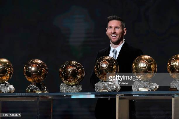 Lionel Messi poses onstage with after winning his sixth Ballon D'Or award during the Ballon D'Or Ceremony at Theatre Du Chatelet on December 02 2019...