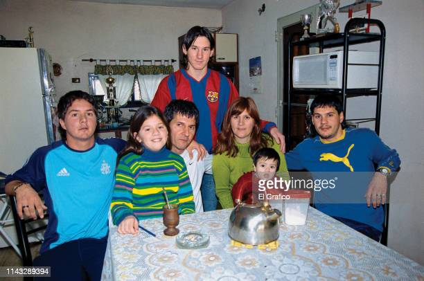 Lionel Messi poses with his brother Rodrigo , sister María Sol, father Jorge, mother Celia, nephew Tomás and brother Matías during a private photo...