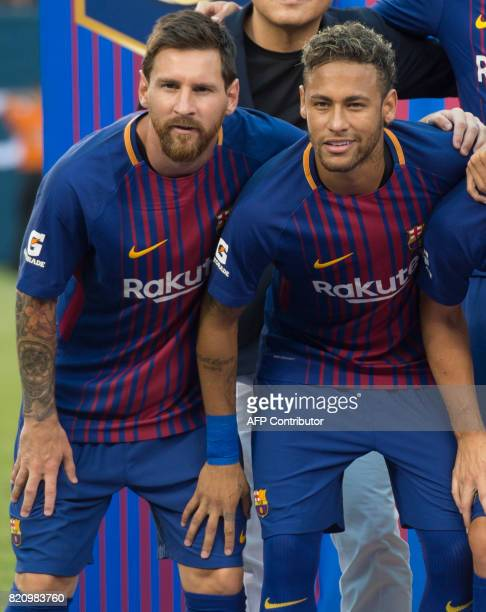 Lionel Messi poses with Neymar before their International Champions Cup match between Juventus FC and FC Barcelona at the Met Life Stadium in East...