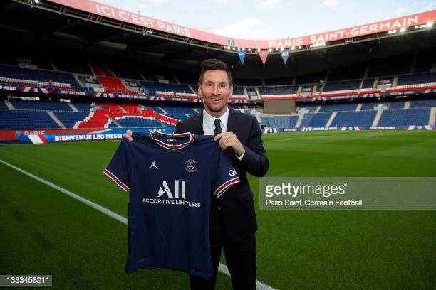 Lionel Messi poses with the Paris Saint-Germain jersey after signing a 2 year contract at Parc des Princes on August 10, 2021 in Paris, France.