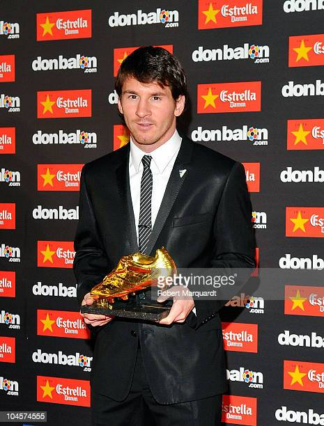 Lionel Messi receives the Golden Boot award wearing Dolce Gabbana clothing at the Old Estrella Damn Factory on September 30 2010 in Barcelona Spain