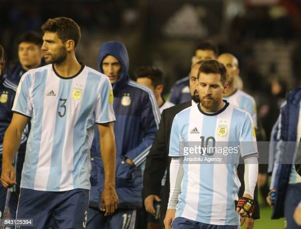 Lionel Messi retires from the field with Federico Fazio of Argentina during the 2018 FIFA Argentina football match between Argentina and Venezuela at...