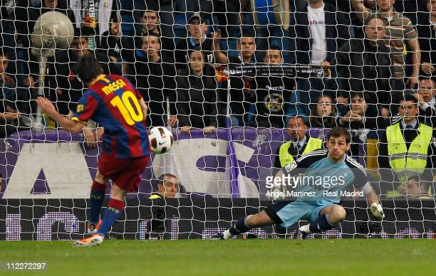 Lionel Messi scores a penalty kick against goalkeeper Iker Casillas of Real Madrid during the La Liga match between Real Madrid and Barcelona at...
