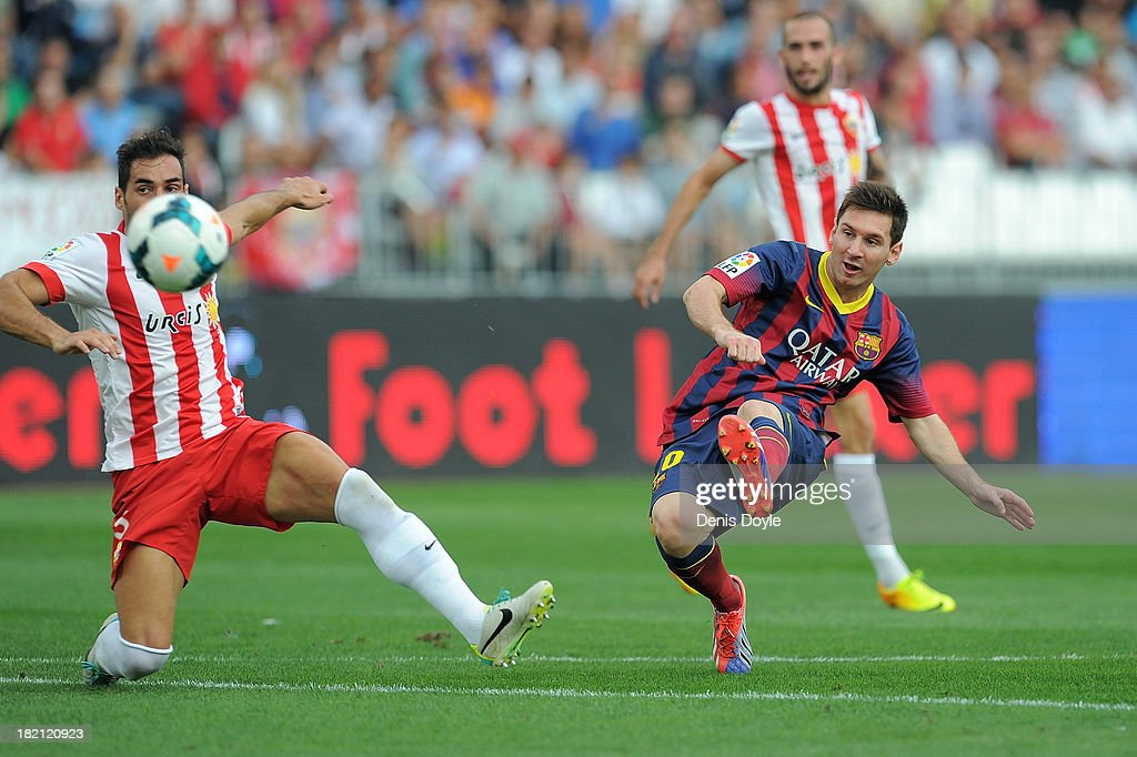 Lionel Messi scores FC Barcelona's opening goal during the La Liga match between UD Almeria and FC Barcelona on September 28, 2013 in Almeria, Spain.