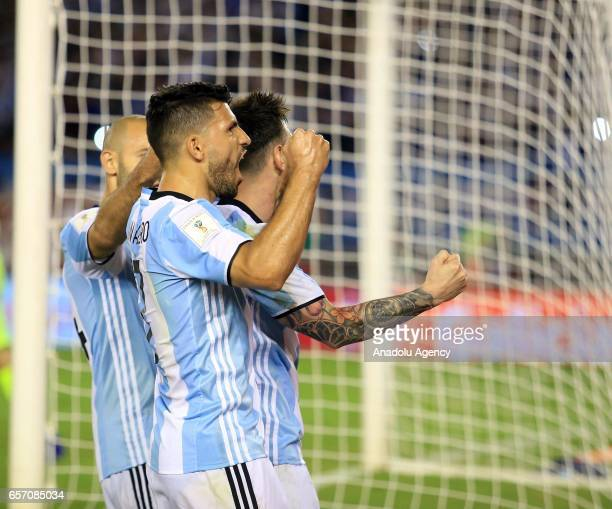 Lionel Messi Sergio Aguero and Javier Mascherano of Argentina celebrate scoring a goal during the FIFA 2018 World Cup Qualifiers football match...