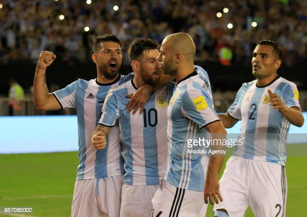 Lionel Messi Sergio Aguero Javier Mascherano and Gabriel Mercado of Argentina celebrate scoring a goal during the FIFA 2018 World Cup Qualifiers...