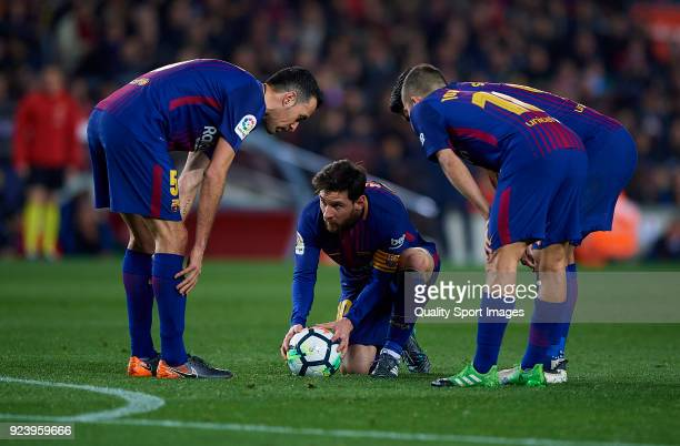 Lionel Messi Sergio Busquets and Jordi Alba of Barcelona talks during the La Liga match between Barcelona and Girona at Camp Nou on February 24 2018...
