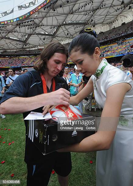 Lionel Messi signing a ball during the men's gold match of football event between Nigeria and Argentina at Beijing 2008 Olympic Games in the National...