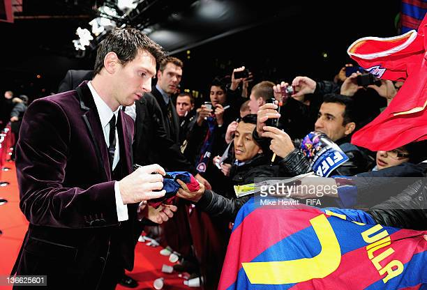 Lionel Messi signs autographs for fans on the red carpet prior to the FIFA Ballon d'Or Gala 2011 at the Kongresshaus on January 09 2012 in Zurich...