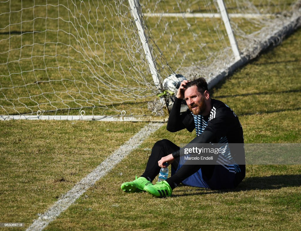 Lionel Messi sits on the ground during a training session open to the public as part of the team preparation for FIFA World Cup Russia 2018 at Tomas Adolfo Duco Stadium on May 27, 2018 in Buenos Aires, Argentina.