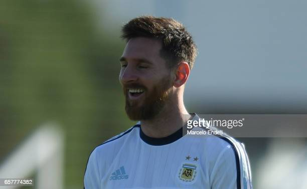 Lionel Messi smiles during a training session at Argentine Football Association 'Julio Humberto Grondona' training camp on March 25 2017 in Buenos...