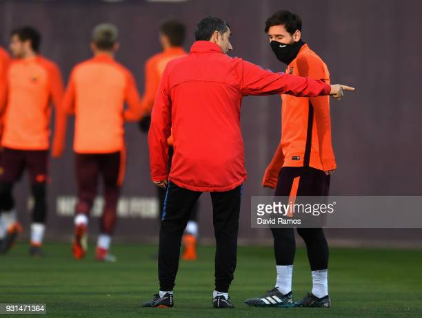 Lionel Messi speaks with Manager of Barcelona Ernesto Valverde during a Barcelona during a Barcelona training session ahead of their UEFA Champions...