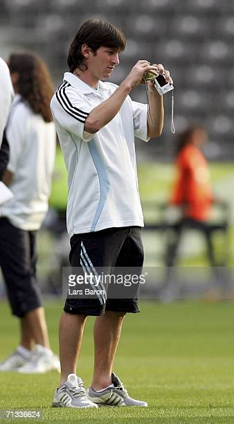 Lionel Messi takes a picture during the Argentina National Football Team training session at the Olympic Stadium Berlin on June 29 2006 in Berlin...