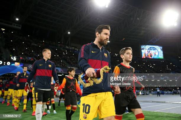 Lionel Messi the captain of Barcelona leads his side onto the pitch during the UEFA Champions League round of 16 first leg match between SSC Napoli...