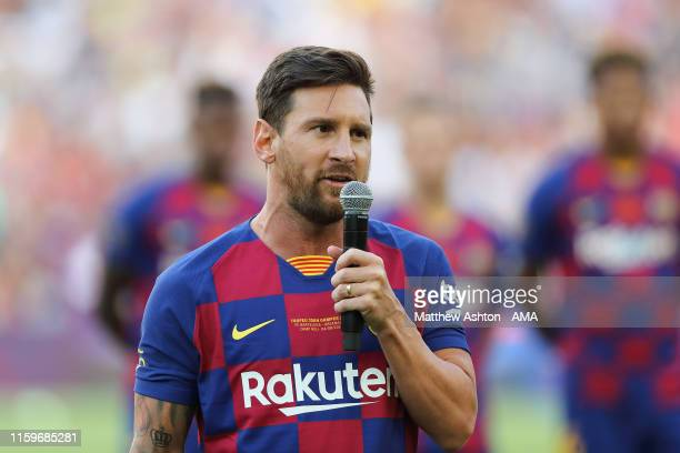 Lionel Messi the captain of FC Barcelona gives a speech to the crowd prior to the PreSeason Friendly between FC Barcelona and Arsenal at Nou Camp on...