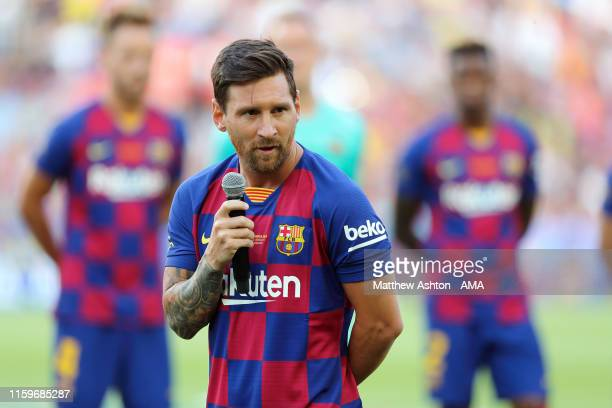 Lionel Messi the captain of FC Barcelona gives a speech to the crowd prior to the Pre-Season Friendly between FC Barcelona and Arsenal at Nou Camp on...