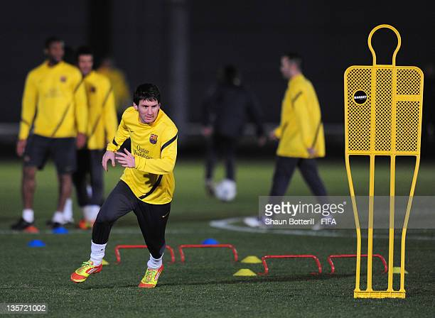 Lionel Messi warms up during the Barcelona training at Marinos Town on December 13 2011 in Yokohama Japan