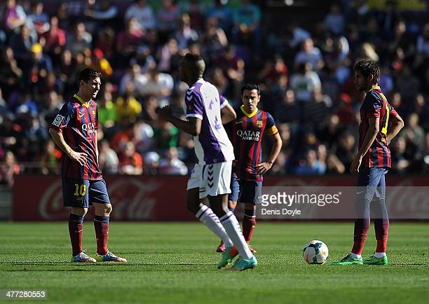 Lionel Messi Xavi Hernandez and Neymar of FC Barcelona react after Real Valladolid CF scored their opening goal during the La Liga match between Real...