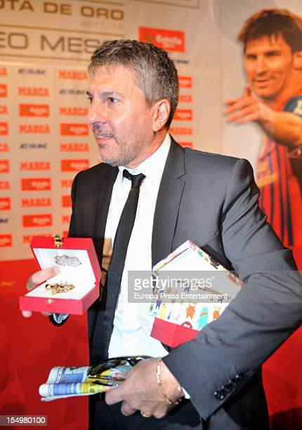 Lionel Messi's father Jorge Horario Messi holding the Golden Bootee for his future grandson during the ceremony of the European Golden Boot 2012...