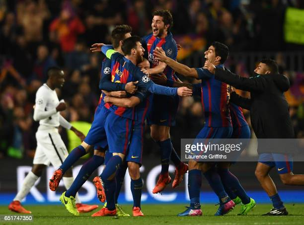 Lionel Messi,Sergio Roberto and Luis Suarez of Barcelona celebrate on the final whistle during the UEFA Champions League Round of 16 second leg match...