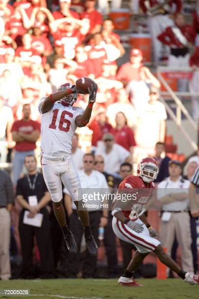 Lionel Mitchell of the Alabama Crimson Tide intercepts a pass against the Arkansas Razorbacks at Donald W Reynolds Stadium on September 23 2006 in...