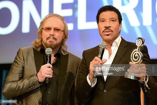 Lionel Richie accepts the O2 Silver Clef Award from Barry Gibb during the Nordoff Robbins O2 Silver Clef Awards on July 1 2016 in London United...