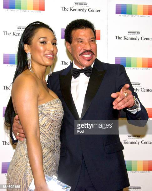 Lionel Richie and girlfriend Lisa Parigi arrive for the formal Artist's Dinner honoring the recipients of the 40th Annual Kennedy Center Honors...