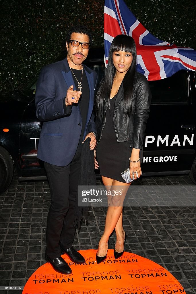 Lionel Richie and guest attend the Topshop Topman LA Opening Party held at Cecconi's Restaurant on February 13, 2013 in Los Angeles, California.