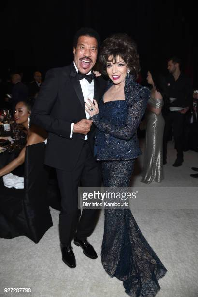 Lionel Richie and Joan Collins attend the 26th annual Elton John AIDS Foundation Academy Awards Viewing Party sponsored by Bulgari celebrating EJAF...