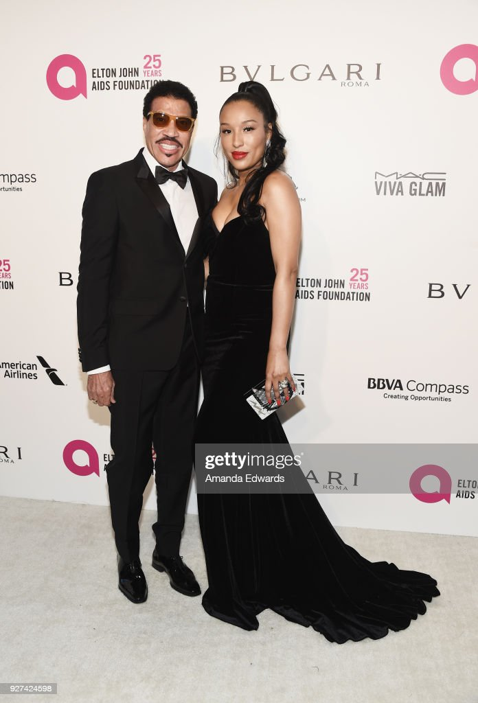 Lionel Richie (L) and Lisa Parigi arrive at the 26th Annual Elton John AIDS Foundation's Academy Awards Viewing Party on March 4, 2018 in West Hollywood, California.