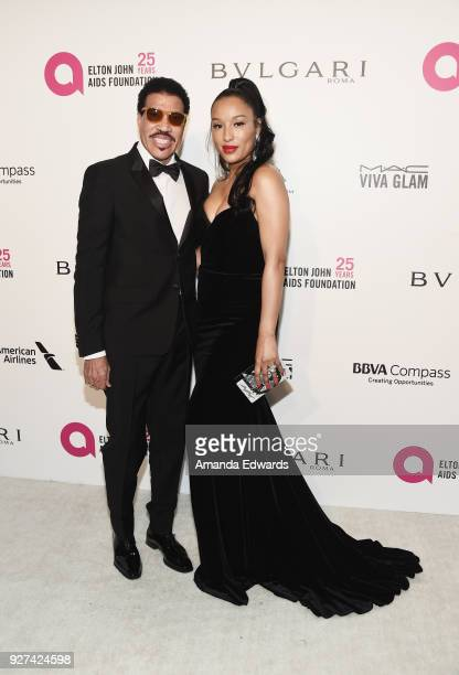 Lionel Richie and Lisa Parigi arrive at the 26th Annual Elton John AIDS Foundation's Academy Awards Viewing Party on March 4 2018 in West Hollywood...