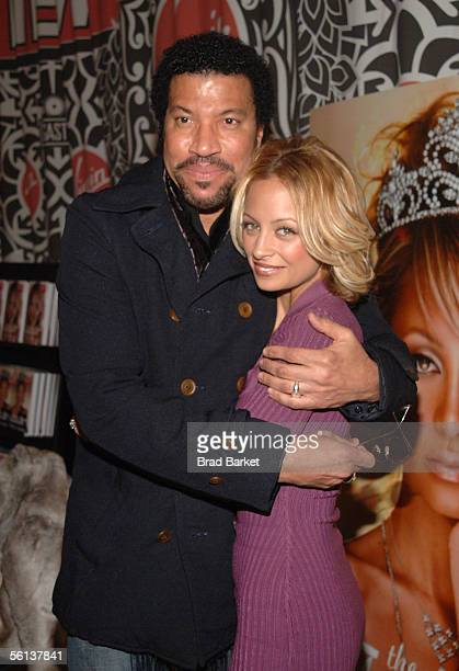 Lionel Richie and Nicole Richie share a moment at the 'The Truth About Diamonds' book signing at the Virgin Mega Store in Times Square on November 10...