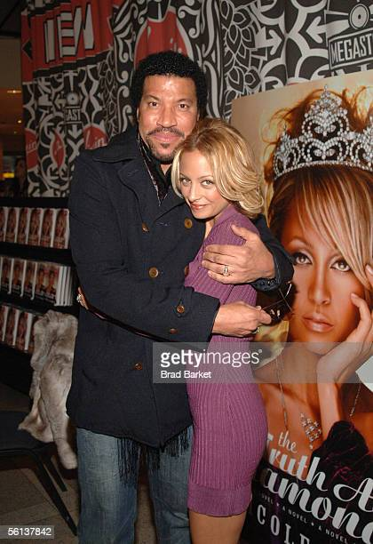 """Lionel Richie and Nicole Richie share a moment at the """"The Truth About Diamonds"""" book signing at the Virigin Mega Store in Times Square on November..."""