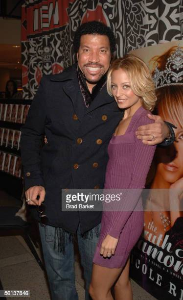 Lionel Richie and Nicole Richie share a moment at the The Truth About Diamonds book signing at the Virigin Mega Store in Times Square on November 10...