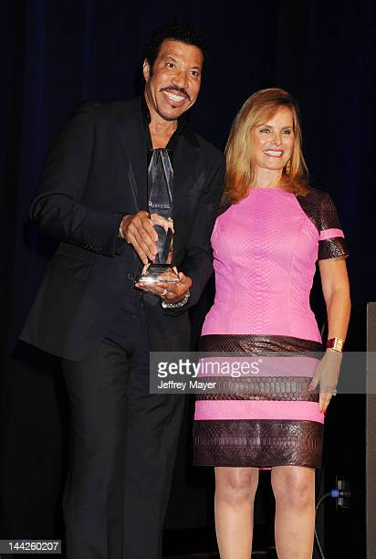 Lionel Richie and Rachelle Friedman attend the NARM Music Biz Awards Dinner Party held at the Hyatt Regency Century Plaza on May 10 2012 in Century...