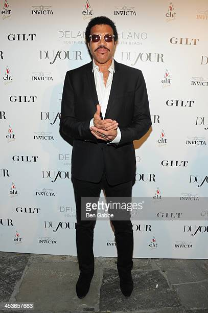 Lionel Richie attends DuJour Magazine's event to honor artist Marc Quinn at Delano South Beach Club on December 4 2013 in Miami Beach Florida