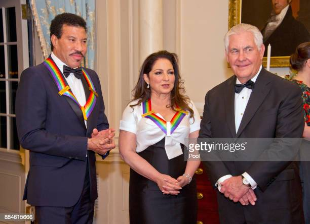 Lionel Richie left and Gloria Estefan center two of the five recipients of the 40th Annual Kennedy Center Honors speak with United States Secretary...
