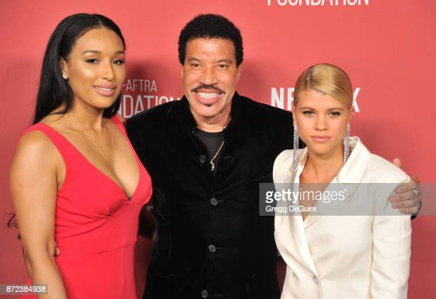 Lionel Richie Lisa Parigi and Sofia Richie arrive at the SAGAFTRA Foundation Patron of the Artists Awards 2017 on November 9 2017 in Beverly Hills...
