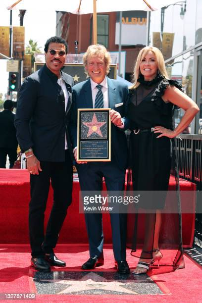 Lionel Richie, Nigel Lythgoe, and Mary Murphy attend a ceremony honoring Television Producer Nigel Lythgoe with a star on the Hollywood Walk Of Fame...