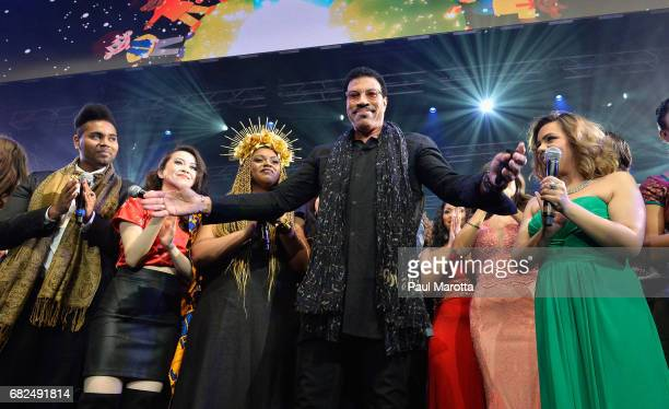 Lionel Richie on stage with students singing We Are The World at the Berklee College of Music Commencement Concert at Agganis Arena at Boston...