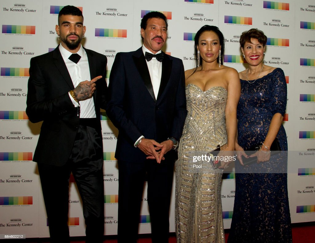 Lionel Richie, second left, arrives with son Miles, left, and girlfriend Lisa Parigi, second right, and sister Deborah Richie, right, for the formal Artist's Dinner honoring the recipients of the 40th Annual Kennedy Center Honors hosted by United States Secretary of State Rex Tillerson at the US Department of State on December 2, 2017 in Washington, DC. The 2017 honorees are: American dancer and choreographer Carmen de Lavallade; Cuban American singer-songwriter and actress Gloria Estefan; American hip hop artist and entertainment icon LL Cool J; American television writer and producer Norman Lear; and American musician and record producer Lionel Richie.