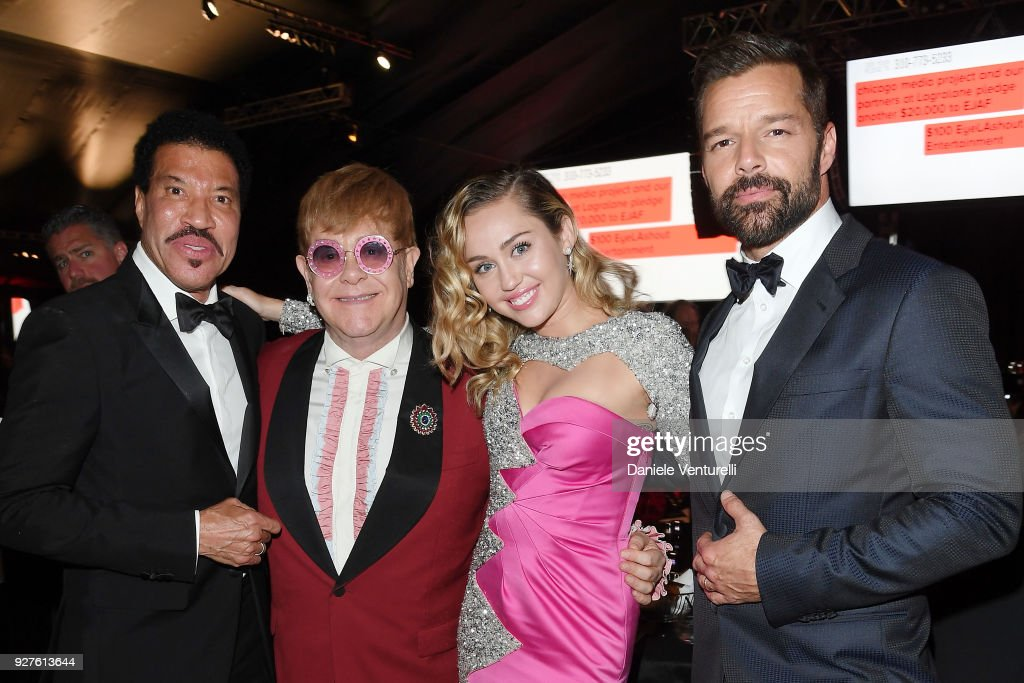 Lionel Richie, Sir Elton John, Miley Cyrus, and Ricky Martin attend Elton John AIDS Foundation 26th Annual Academy Awards Viewing Party on March 4, 2018 in Los Angeles, California.