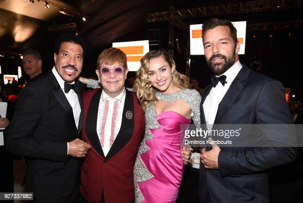 Lionel Richie, Sir Elton John, Miley Cyrus, and Ricky Martin attend the 26th annual Elton John AIDS Foundation Academy Awards Viewing Party sponsored...