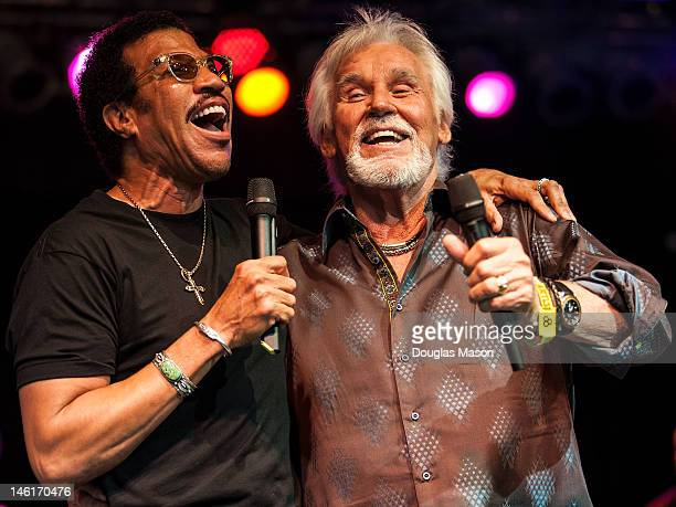 Lionel Richie sits in with Kenny Rogers during the 2012 Bonnaroo Music and Arts Festival on June 10 2012 in Manchester Tennessee