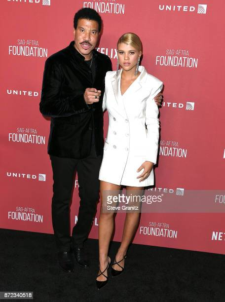 Lionel Richie Sofia Richie arrives at the SAGAFTRA Foundation Patron of the Artists Awards 2017 on November 9 2017 in Beverly Hills California
