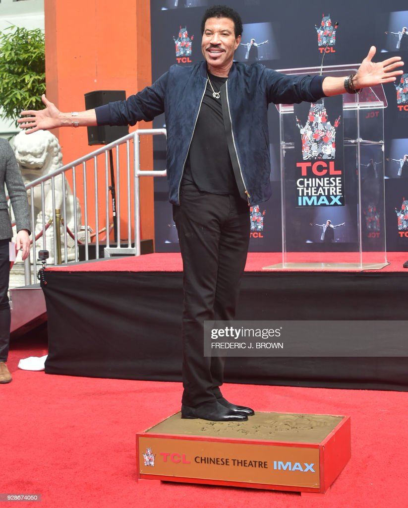 Lionel Ritchie attends his Hand and Footprints ceremony on March 7,2018 in Hollywood, California. /