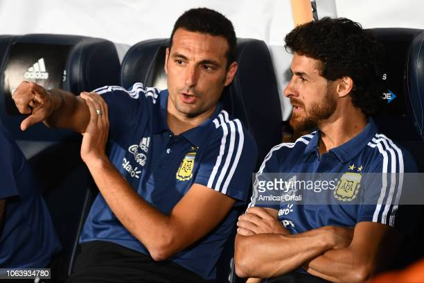Lionel Scaloni head coach of Argentina talks with Pablo Aimar during a friendly match between Argentina and Mexico at Malvinas Argentinas Stadium on...